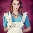 Portrait of a young redhead woman dressed as Alice in Wonderland — Stock Photo