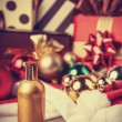 Perfume and christmas gifts — Stock Photo