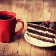 Cup of coffee with cake — Stock Photo
