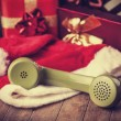 Handset and christmas gifts at background — Stock Photo