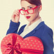 Women in glasses with gift — Stock Photo