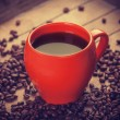 Red cup of coffee on wooden table — Stock Photo #35514031