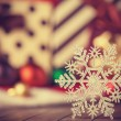 Snowflake and christmas gifts.  — Stock Photo