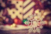 Snowflake and christmas gifts. — Stock Photo