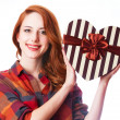 Redhead girl with gift. — Foto de Stock