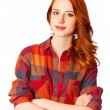 Redhead girl in shirt on white background isolated. — Stock Photo
