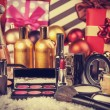 Stock Photo: Cosmetics on christmas gifts