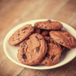 Cookies at wooden background — Stock Photo