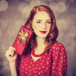 Redhead women with gift.  — Stock Photo
