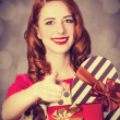 Redhead girl with gift for Valentines Day — Stock Photo