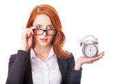 Redhead girl with clock — Stock Photo
