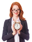 Redhead girl with clock — Stockfoto