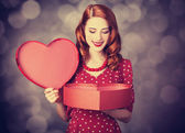 Redhead girl with gift for Valentines Day. — Stock Photo