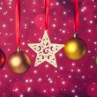 Christmas balls and star on ribbon — Stock Photo
