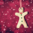 Gingerbread man on ribbon. — Stock Photo