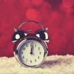 Alarm clock on snow — Stock Photo