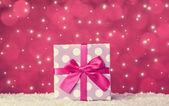 Gift box on snow — Stock Photo