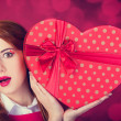 Redhead girl with shape heart box. — Stock Photo