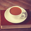 Cup of coffe with book — Stockfoto