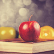 Apple and the book. — Stock Photo #36363963