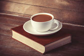 Cup of coffe with book — Stock Photo