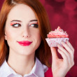Redhead girl with cake. — Stock Photo