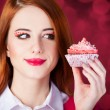Redhead girl with cake. — Stock Photo #36397849
