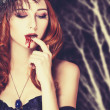 Redhead vampire woman in mask — Stock Photo #36879585