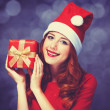 Redhead girl with gifts on purple background — Stockfoto