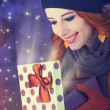 Redhead girl with gift.  — Stock Photo