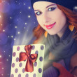 Stock Photo: Redhead girl with gift.