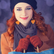 Stock Photo: Redhead with with bag.