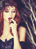 Redhead vampire woman in mask — Stock Photo