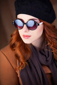 Style redhead women in sunglasses. — Stock Photo