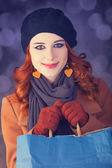 Redhead with with bag. — Stock Photo