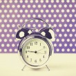 Retro alarm clock on a table — Stockfoto