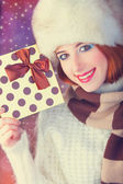 Beautiful redhead women with gift. — Stock Photo