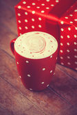 Cup of coffee with gift — Stock Photo