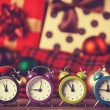 Stock Photo: Vintage clocks on christmas background.