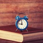 Alarm clock and book. — Stock Photo #38249361