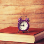 Alarm clock and book. — Stock Photo #38249371