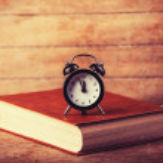 Alarm clock and book. — Stock Photo #38249375