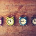 Retro alarm clocks on a table. — Stock Photo #38249463