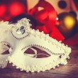 Mask for carnival near gifts. — Stock Photo