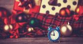 Vintage clock on christmas background. — Stock Photo
