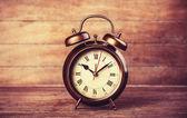 Retro alarm clock on a table. — Stock Photo
