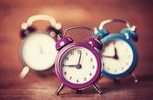 Retro alarm clocks on a table. — Foto de Stock