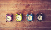 Retro alarm clocks on a table. — ストック写真