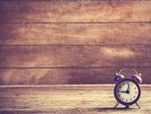 Retro alarm clock on a table — Stock Photo