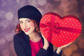 Redhead girl with shape heart box. — Stock Photo